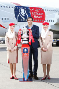 David-James-&-cabin-crew-with-the-Emirates-FA-Cup-at-the-unveiling-of-the-new-Emirates-FA-Cup-decal