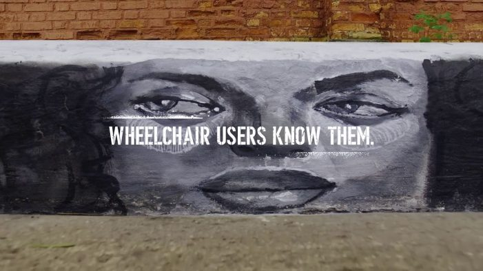 Graffiti art shows that sidewalk curbs without ramps become walls for wheelchair users