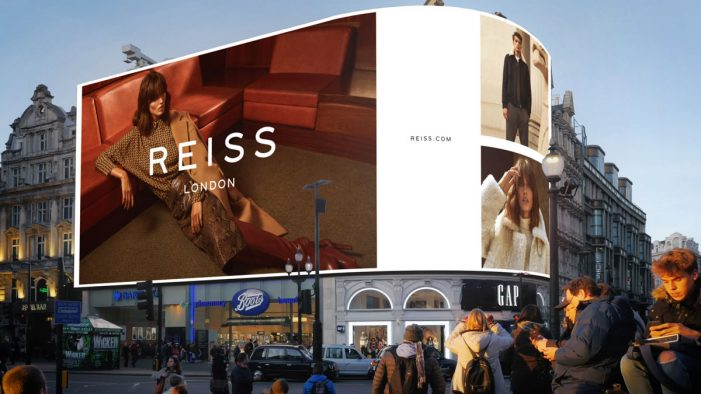 Reiss unveils its AW19 push on London's Piccadilly Lights following strong sales in the first half of the year
